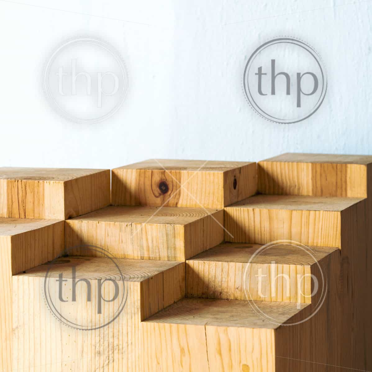 Geometric shapes in abstract blocks of wood with copy space